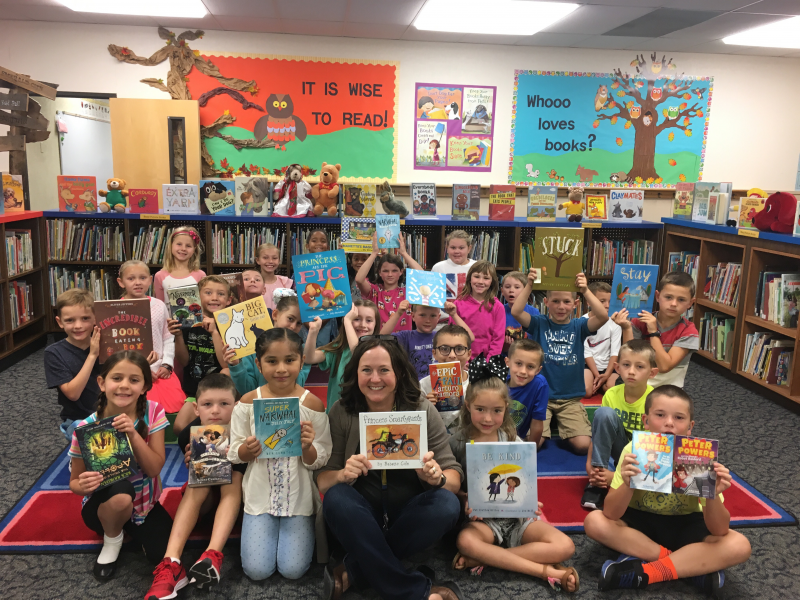 Elementary School students with books donated by Canby Rotary Club.