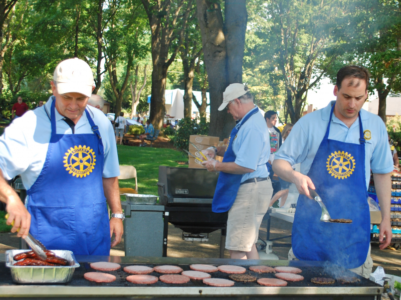 Troy Buzalsky, Randy Carson and Judd Palmer flipping burgers at the annual Car Show BBQ