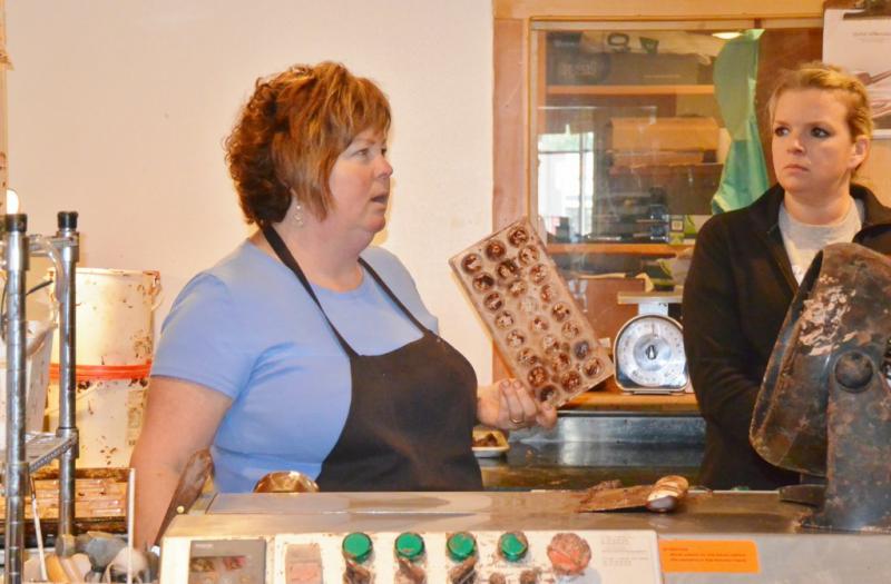 Owner/Chocolatier demonstrating chocolate candy making