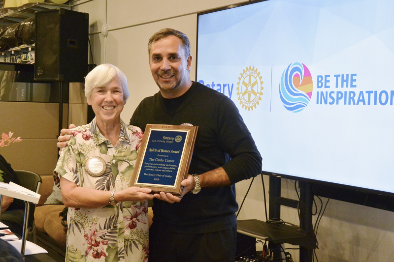 Past President Kathleen presenting Spirit of Rotary award to Ray Keen, Director of the Canby Center.