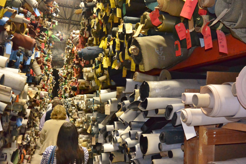 Rolls and rolls of fabrics as far as you can see in the warehouse.