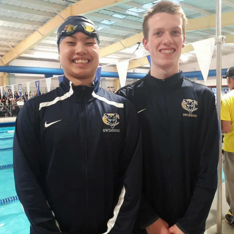 Wout participated on the Canby High School swim team - he's with a team mate during a swim meet.